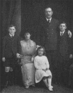 "Arthur and Jean with Denis, Adrian, and Lena Jean. This photo was used as a frontispiece for ""Pheneas Speaks,"" supposedly containing words of wisdom from Jean's spirit guide."